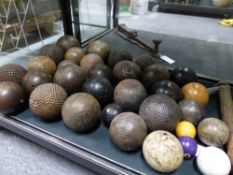 A COLLECTION OF FRENCH BOULLE BALLS OF STUDDED NAIL TYPE, VARIOUS BOWLING WOOD AND OTHER GAMES BALLS