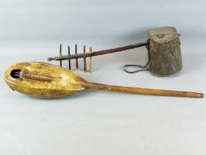AN AFRICAN NGONI, A MUSICAL STRING INSTRUMENT WITH HIDE COVERED GOURD BODY TOGETHER WITH A FURTHER