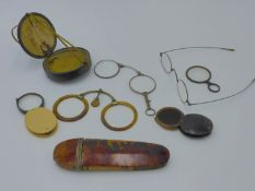 A PAIR OF ORIENTAL FOLDING SPECTACLES OR PINZ NEZ CONTAINED IN ORIGINAL LEATHER BOUND CASE