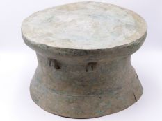 A SOUTH EAST ASIAN ARCHAIC FORM BRONZE RAIN DRUM, THE TOP WITH RAISED CENTRAL STAR AND LINEAR
