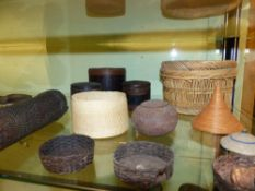 A GROUP OF SMALL TRIBAL WOVEN BASKETS, LIDDED BOXES AND COVERS.