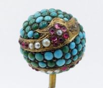 A 19TH CENTURY HAT PIN, THE BALL FORM TOP INSET WITH TURQUISE AND DECORATED WITH ENCIRCLING GOLD