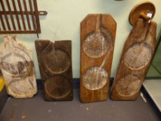 A GROUP OF FOUR EUROPEAN CHEESE MOULD BOARDS, EACH WITH TWIN CARVED RECESSES TOGETHER WITH TWO