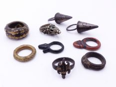 THREE ANTIQUE WHITE METAL POMANDER RINGS, TWO UNUSUAL IRON RINGS DECORATED WITH CHAMELION AND