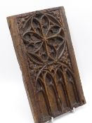 A 16TH/17TH CENTURY CARVED OAK PANEL WITH GOTHIC ARCH DECORATION, A FURTHER SMALL PANEL AND A