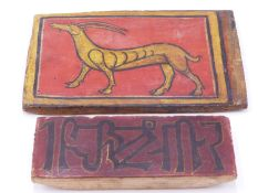 AN INDO PERSIAN PAINTED PANEL DEPICTING A DEER, A CARVED AND PAINTED DOOR PANEL, TWO CARVED PANELS