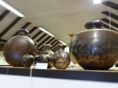 A LARGE INDIAN STEEL GLOBULAR FORM VESSEL AND FOUR SIMILAR SMALLER. (5)