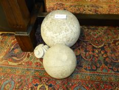 TWO EARLY LARGE CARVED LIMESTONE SPHERES 30 CM AND SMALLER