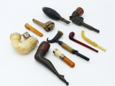 A SMALL CASED RED AMBER SMOKING PIPE, TWO AMBER AND MEERSCHAUM CHEROOT HOLDERS, A LONG ART DECO