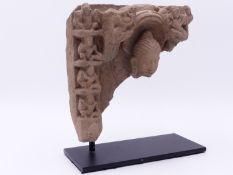A WELL CARVED SANDSTONE STELE FRAGMENT OF BUDDHA ENSHRINED WITH ATTENDANT FIGURES TO BORDER.