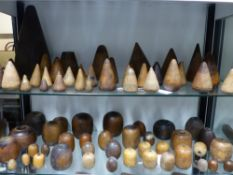 A LARGE COLLECTION OF TREEN, HARDWOOD PLUMBERS FORMS, CONES, BEADS ETC. (QTY).