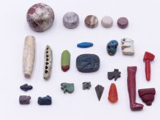 A COLLECTION OF ANCIENT EGYPTIAN AND OTHER ARTEFACTS TO INCLUDE A WEDJAT EYE BEAD, A BLUE FAIENCE