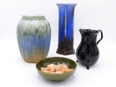 A RUSKIN POTTERY VASE WITH STREAKED GLAZE, ANOTHER UNSIGNED VASE, A SMALL MOORCROFT PIN DISH AND