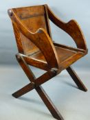 A GOOD 19TH CENTURY FRUIT WOOD GLASTONBURY ARMCHAIR WITH X FORM SUPPORTS.