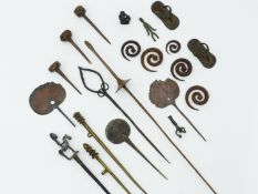 A WEST AFRICAN DOGON PEOPLE BRONZE HAIRPIN SURMOUNTED WITH HORSE AND RIDER, THREE SHORT COPPER
