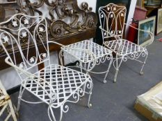 A PAIR OF PAINTED WROUGHT IRON ARMCHAIRS AND A SMALL TABLE