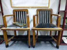 A PAIR OF ART DECO OAK AND EBONISED ARMCHAIRS