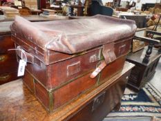 AN UNUSUAL AND RARE ANTIQUE BRASS BOUND LEATHER EXPANDING TRAVELLING TRUNK. WITH BRASS LABEL W.