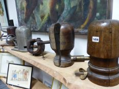 FOUR ANTIQUE WOODEN HAT STRETCHERS TOGETHER WITH AN UNUSUAL LARGE ALLOY EXAMPLE