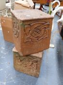 A PAIR OF LIBERTY & CO ART NOUVEAU TERRACOTTA PLINTHS WITH INTERLACED DECORATION.