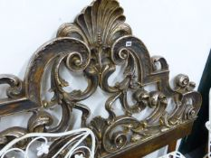 A CLASSICAL CARVED WOOD SCROLL FORM BEDHEAD