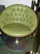 A PAIR OF LEATHER UPHOLSTERED TUB FORM EGG SWIVEL CHAIRS