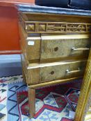 AN AMERICAN WALNUT MARBLE TOP FOUR DRAWER SIDE CABINET