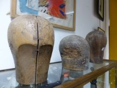 A GROUP OF SEVEN VARIOUS WOOD AND LEATHER MILLINER'S HAT BLOCKS