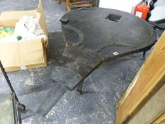 A LARGE RECLAIMED BLACKSMITH BELLOW COFFEE TABLE.