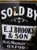 """AN ENAMEL SIGN: E J BROOKS & SON OXFORD """"SOLD BY"""""""