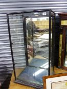 A VICTORIAN EBONISED DISPLAY CASE