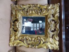 AN ANTIQUE ITALIAN BAROQUE STYLE CARVED GILTWOOD FRAME WITH LATER MIRROR PLATE, REBATE 26 X 19CM