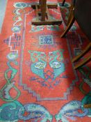 AN ARTS AND CRAFTS RED GROUND RUG