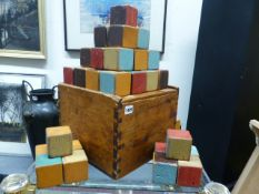 A BOXED SET OF WOODEN CHILD'S BUILDING BLOCKS