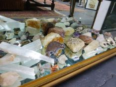 A COLLECTION OF VARIOUS ROCKS, CRYSTALS AND MINERALS