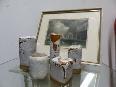 A GROUP OF FOUR ART POTTERY PILLARS TOGETHER WITH AN ENGRAVING OF STONEHENGE