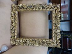 TWO ANTIQUE CARVED GILTWOOD FLORENTINE FRAMES, REBATES 13.5 X 11CM AND 32 X 41CM