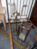 AN UNUSUAL VINTAGE GOLF RELATED SMOKING STAND. A STICK STAND AND A BRASS FIRE FENDER