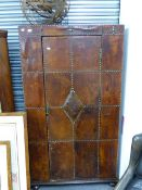AN UNUSUAL EARLY 20TH.C.LEATHER UPHOLSTERED HALL CUPBOARD