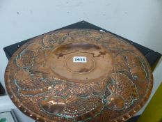 A NEWLYN SCHOOL COPPER PLATTER IN THE MANNER OF PEARSON WITH FISH DECORATION