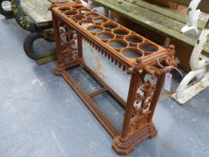 AN ANTIQUE CAST IRON STICKSTAND IN THE MANNER OF COALBROOKDALE WITH TWIN HANDLE ENDS ABOVE FOLIATE