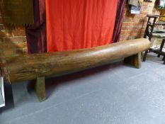 """A LARGE ORIENTAL """"LOG"""" STOOL ON BLOCK SUPPORTS"""