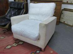 A DESIGNER DEEP SEAT ARMCHAIR ON CHROME LEGS