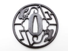 A PIERCED IRON TSUBA, DECORATED WITH STYLIZED CLOUDS AND LIGHTENING BOLTS