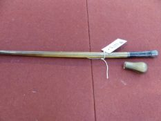 A SILVER MOUNTED HORN CROP OR SWAGGER STICK AND A HORN CANE TOP