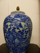 A CHINESE BLUE AND WHITE BALUSTER FORM VASE MOUNTED AS A LAMP AND AN EASTERN BLUE AND WHITE