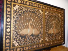 A LARGE EASTERN NEEDLEWORK PANEL OF TWO PEACOCKS, FRAMED, 142CM HIGH X 218CM WIDE OVER ALL.