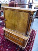 A VICTORIAN WALNUT MUSIC CABINET WITH TWO DRAWER BASE. 62cms WIDE