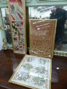 A VICTORIAN NEEDLEWORK SAMPLER, ANOTHER OF SAMPLE DESIGNS AND A N EMBROIDERED BALKAN FLORAL PANEL