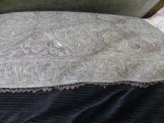 AN EASTERN METAL THREAD NEEDLEWORK PANEL NOW MOUNTED AS A CUSHION